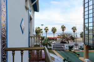 A balcony or terrace at Guadalupe Cozy Inns