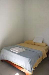 Ein Bett oder Betten in einem Zimmer der Unterkunft Lost and Found Jungle Hostel