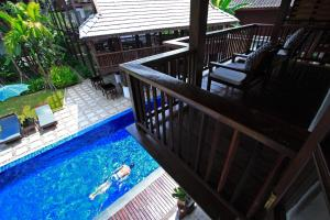 A view of the pool at Banthai Village or nearby