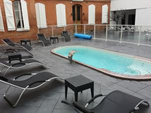 The swimming pool at or near Hôtel Riquet Resort & Spa