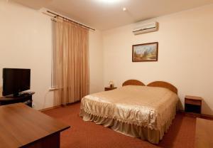 Кровать или кровати в номере Apartments Ullberg