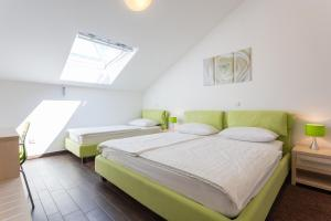 A bed or beds in a room at Apartments Villa Alba
