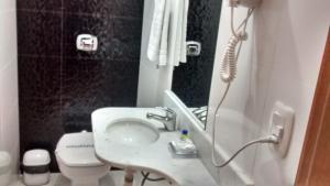 Ванная комната в Turis Hotel