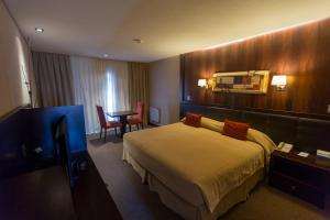 A bed or beds in a room at Imago Hotel & Spa