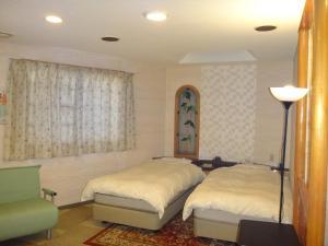 ユーティリティ ホテル クーにあるベッド