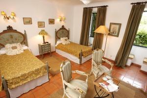 Ein Bett oder Betten in einem Zimmer der Unterkunft Quinta Da Praia Das Fontes