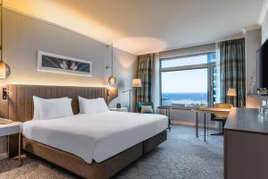 A bed or beds in a room at Hilton Diagonal Mar Barcelona