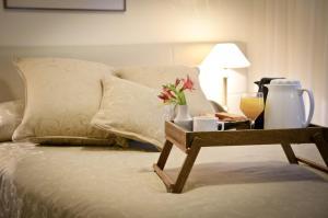Una cama o camas en una habitación de Hotel Presidente