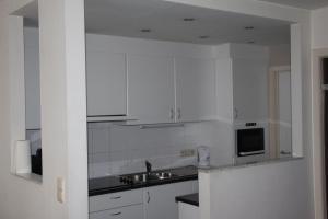 Een keuken of kitchenette bij Mirage