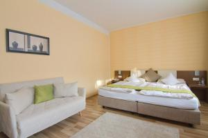A bed or beds in a room at Balance Revital-Hotel