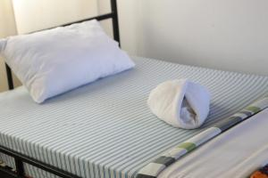 A bed or beds in a room at We Travel Hostel