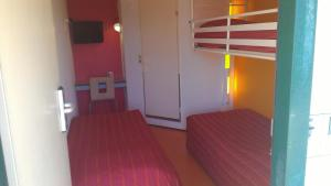 A bed or beds in a room at Premiere Classe Vierzon