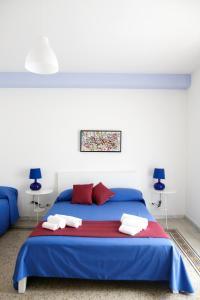 Letto o letti in una camera di B&B Alchimia Napoletana