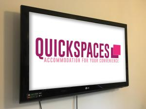A television and/or entertainment center at QuickSpaces Heart of the City
