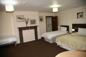 A bed or beds in a room at A Gosport Inn