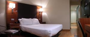 A bed or beds in a room at AC Hotel Almeria