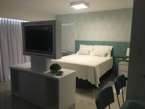 Cama ou camas em um quarto em Loft Barra