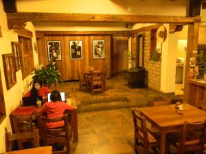 A restaurant or other place to eat at La Troje de Adobe