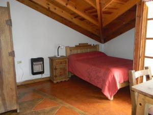 A bed or beds in a room at La Troje de Adobe