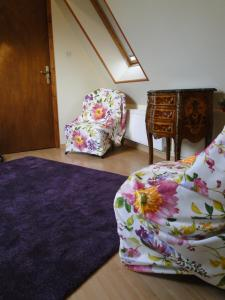 A bed or beds in a room at Residence La Couronne