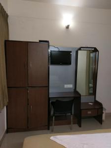A television and/or entertainment center at Banyan Tree Comforts