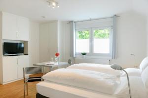 Ein Bett oder Betten in einem Zimmer der Unterkunft Bed & Breakfast Meerbusch