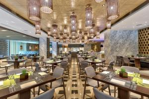 A restaurant or other place to eat at Hilton Kota Kinabalu