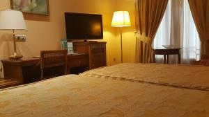 Cama o camas de una habitación en Sercotel Guadiana