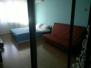 A bed or beds in a room at Apartment on Lukyanenko 95 korp 2
