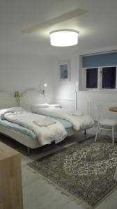 A bed or beds in a room at Royaltybed Copenhagen