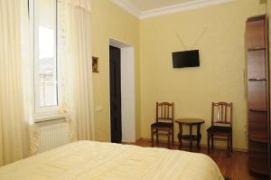 A bed or beds in a room at Grimis Villa