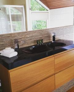 A bathroom at Romantic Treehouse Getaway