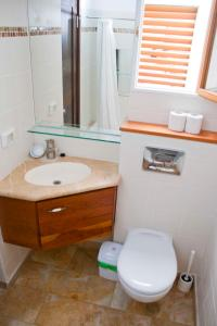 A bathroom at The Market Courtyard - Suites Hotel