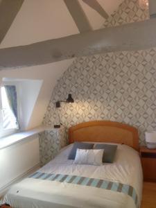 Un ou plusieurs lits dans un hébergement de l'établissement Au Coeur d'Amiens