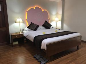 クリスタル パレス ホテルにあるベッド