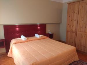Кровать или кровати в номере Hotel Auronzo