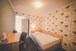 Łóżko lub łóżka w pokoju w obiekcie Pokoje gościnne Truskawkowa 1a