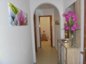A kitchen or kitchenette at Apartamentos AquaRia Fuseta