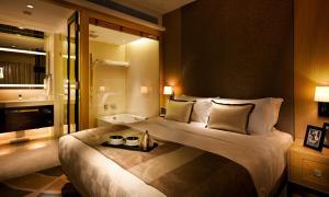 Cama o camas de una habitación en The HarbourView Place @ the ICC megalopolis