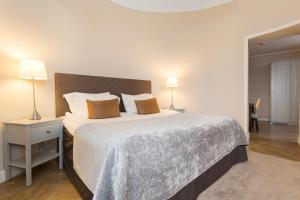 Ein Bett oder Betten in einem Zimmer der Unterkunft Elite Hotel Adlon