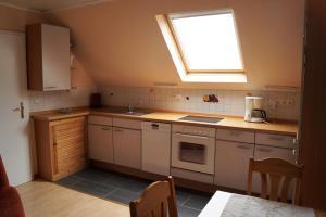 Küche/Küchenzeile in der Unterkunft Ferienwohnung Luise Blum