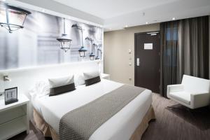 Ein Bett oder Betten in einem Zimmer der Unterkunft Catalonia Avinyo