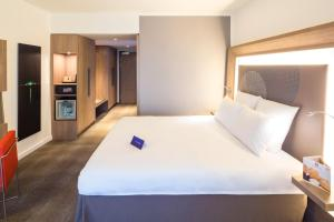 A bed or beds in a room at Novotel Moscow City
