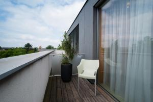 A balcony or terrace at HEINHOTEL Vienna Airport