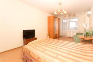 Кровать или кровати в номере Апартаменты Белинского 36