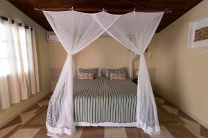 A bed or beds in a room at Pousada Do Rio Mutum