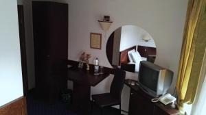 A television and/or entertainment center at Guest House Solo
