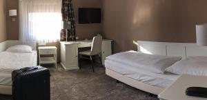 Ein Bett oder Betten in einem Zimmer der Unterkunft City Hotel Antik