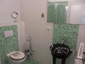 Ein Badezimmer in der Unterkunft Pension Domke
