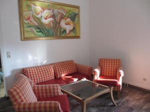 Ein Sitzbereich in der Unterkunft Pension Domke